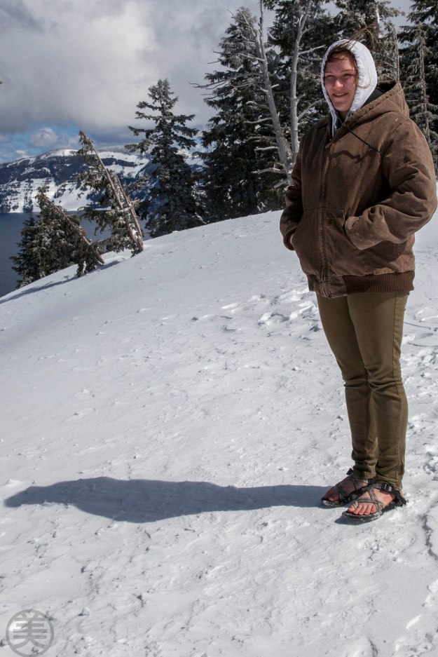 Young girl standing by Crater Lake view point with bare feet...!